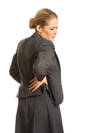 scandinavian descent: Businesswoman having huge back pain Stock Photo