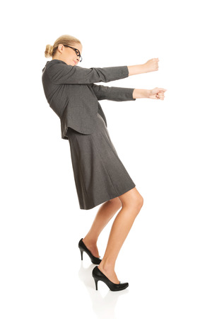 woman handle success: Determined businesswoman pulling a stick