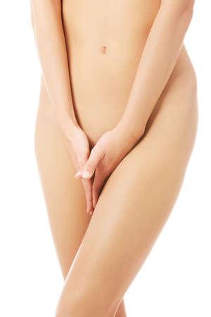 Close up on nude female slim body. Stock Photo