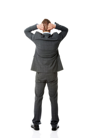 working stiff: Full length businessman putting hands on the nape. Stock Photo