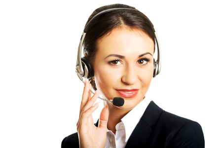 hands free phones: Happy woman as a phone operator in headset. Stock Photo