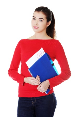 blinder: Pretty female student holding her notes.
