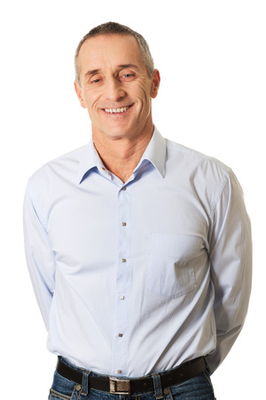arms behind head: Good looking mature man holding arms behind him. Stock Photo