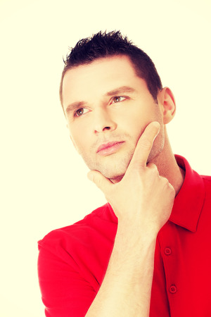 wondering: Handsome young thoughtful man wondering Stock Photo