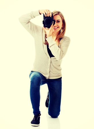 dslr: Woman photographer at work with DSLR