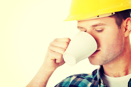 happy workers: Worker on a break drink coffee and have rest