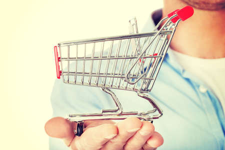 shopping cart: Man with a small shopping basket. Ecommerse concept