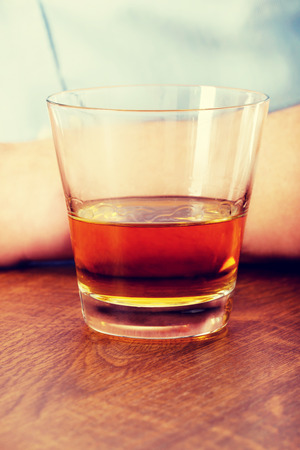 irresponsible: Yound man in depression, drinking whisky