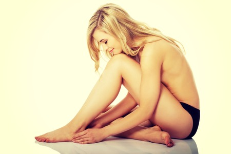 bare breasts: Beautiful caucasian naked woman sitting with fresh clean skin. Stock Photo