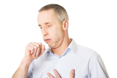 coughing: Mature man coughing because of flu.