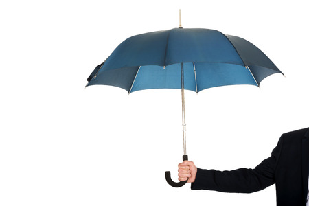 Close up on businessman hand with an umbrella. photo