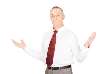 undecided: Businessman with hands open in undecided gesture. Stock Photo