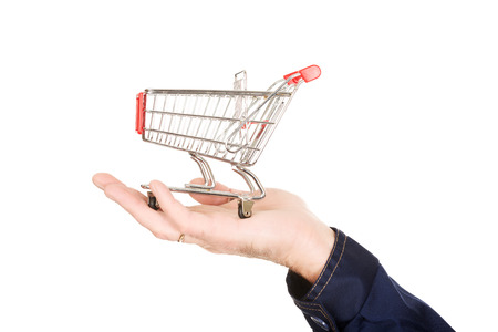 Male hand with small shopping basket. photo