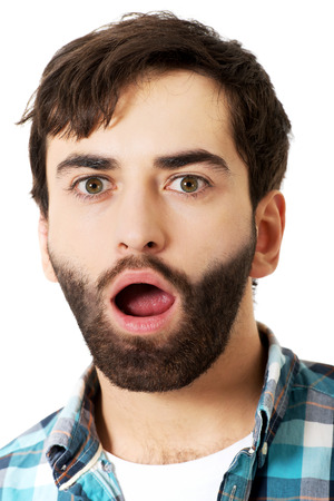 mouth  open: Young handsome shocked man with mouth open.