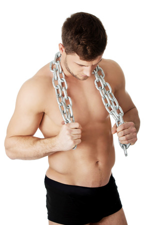 well build: Well build young male model with chains over his neck.