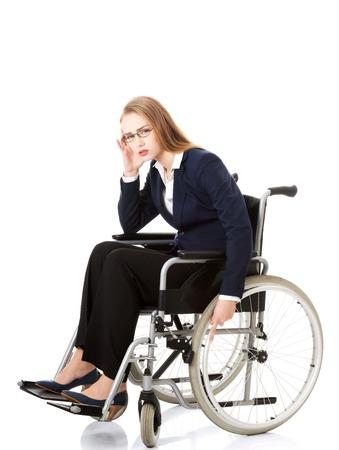 tiring: Tired caucasian businesswoman on a wheelchair Stock Photo