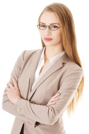 mani incrociate: Fiducioso giovane imprenditrice bella con le mani incrociate