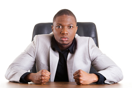 infuriate: Angry african businessman shouting on someone