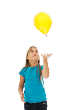 Happy beautiful girl with baloons looking up photo