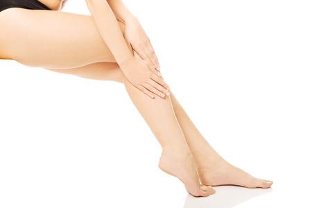 bare ass: Perfect nude slim female legs Stock Photo