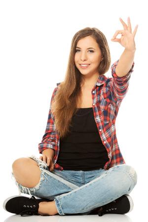 legged: Happy woman sitting cross legged
