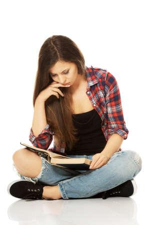 crosslegged: Woman sitting cross-legged and reading Stock Photo
