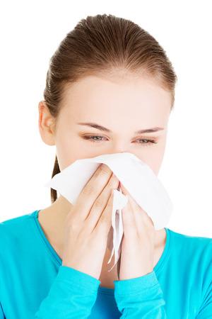 sneezing: Young beautiful blonde woman sneezing