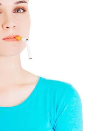 breaking: Young woman breaking a cigarette Stock Photo