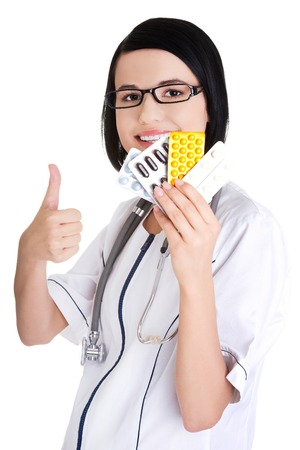 doctor holding pills: Happy female doctor holding pills