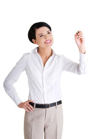 glassboard: Happy businesswoman drawing on a glassboard