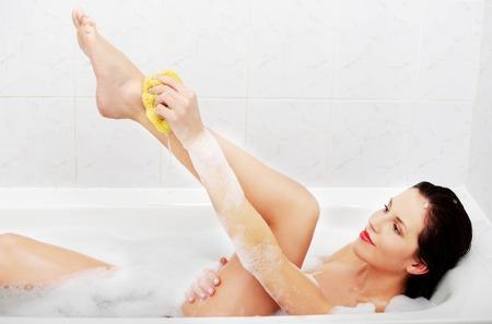 relaxion: Beautiful young slim woman bathing Stock Photo