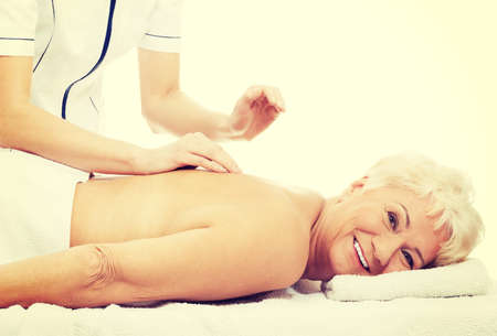 medicalcare: Beautiful old woman is having a massage.