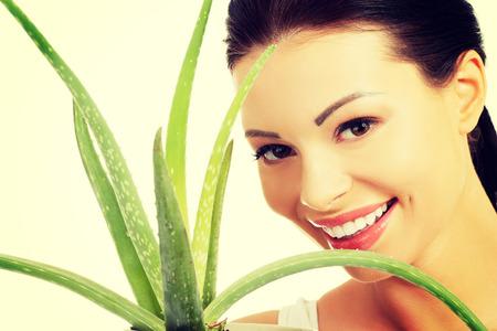 facial hygiene: Beautiful spa woman with aloe vera.