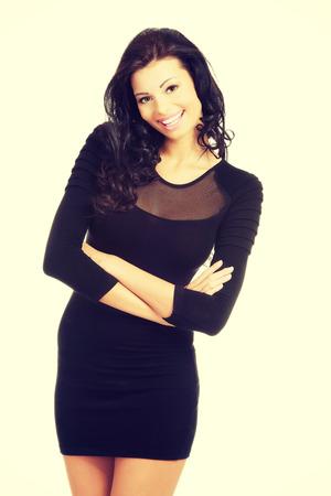 mini dress: Sexy brunette woman wearing black party dress.