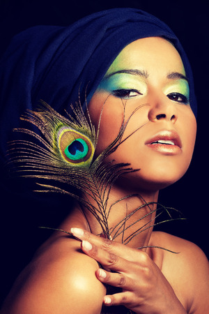 eyeshades: Beauty woman with artistic make up and peacock feather.