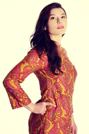 colorful dress: Young beautiful woman wearing colorful dress.