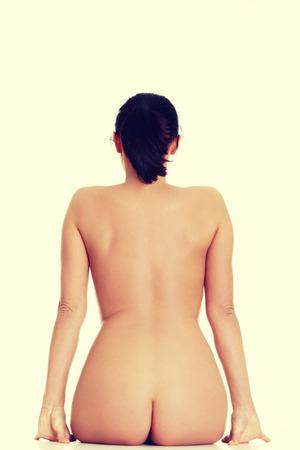 naked woman back: Sexy fit nackte Frau zur�ck zur Kamera.
