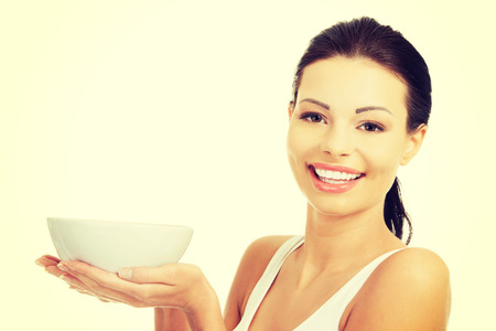 Beautiful caucasian woman holding her hot soup in bowl. Stock Photo