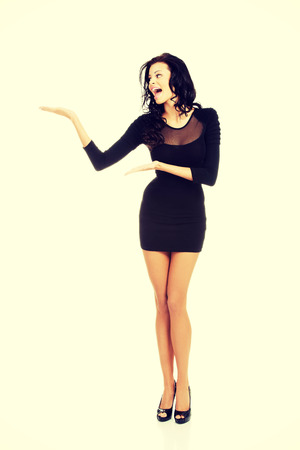 sexy lady: Sexy woman wearing black party dress showing copy space.