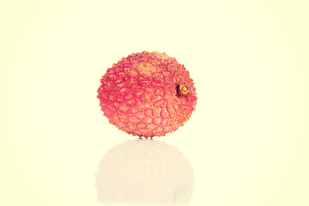 litschi: One separated red lychee fruit. Stock Photo