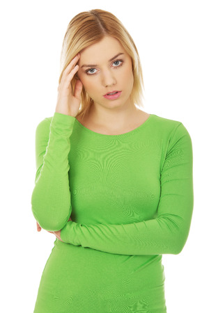Annoyed young woman holding her head. Stock Photo