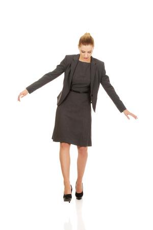 carefully: Beautiful business woman walking carefully. Stock Photo