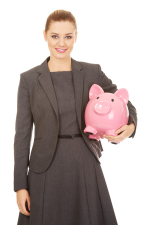 coinbank: Business woman saving money in piggybank.