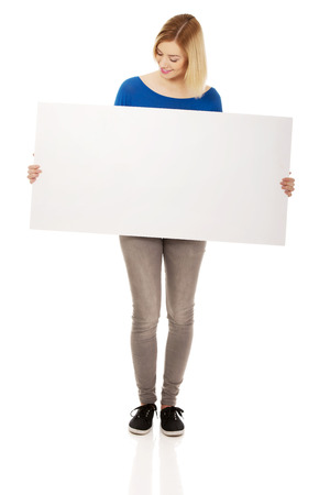 Young happy woman with blank board. photo