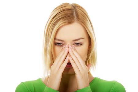 suffering: Beautiful woman suffering from sinus pain. Stock Photo