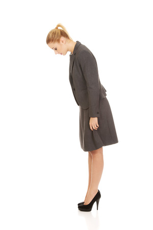 woman looking down: Business woman looking down on copy space.