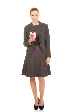 coinbank: Business woman saving money in piggybank.