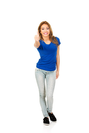 Young beautiful happy woman with thumbs up. photo