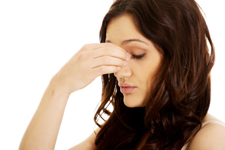sinus: Young woman suffering from sinus pressure pain. Stock Photo