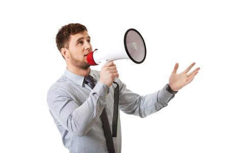 megafono: Apuesto hombre de negocios gritando por meg�fono. Foto de archivo